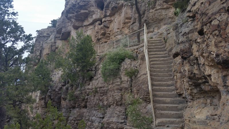 Concrete stairs leading up the side of a cliff at Sandia Man Cave, one of the lesser-known day trips from Albuquerque.