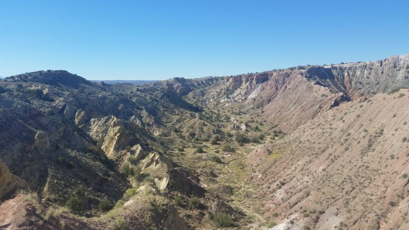 A view of a canyon with a blue sky in the background north of Albuquerque, New Mexico.