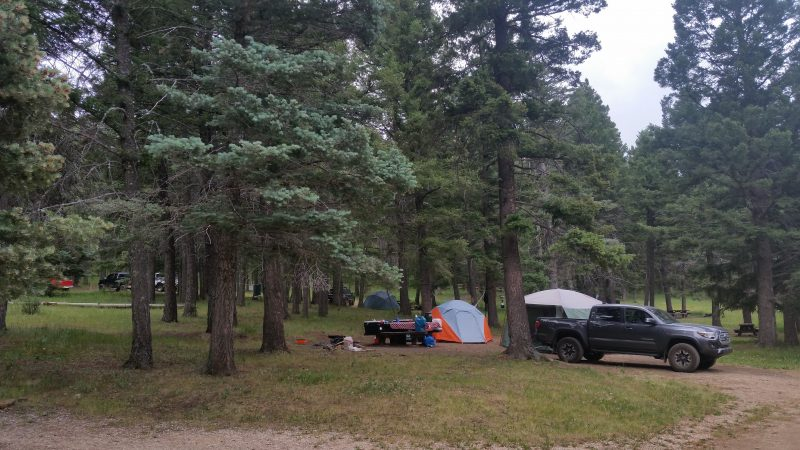 Several tents and a truck at Iron Gate Campground, one the more remote spots for camping near Pecos, NM.