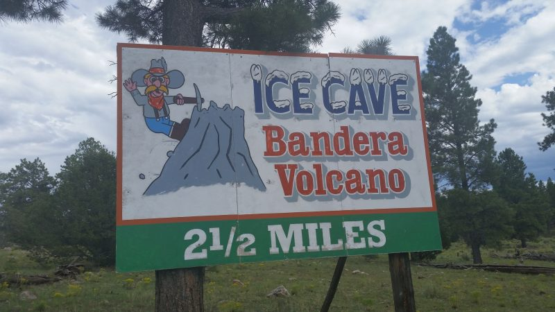 Billboard on the side of the road in New Mexico advertising Bandera Volcano and Ice Caves