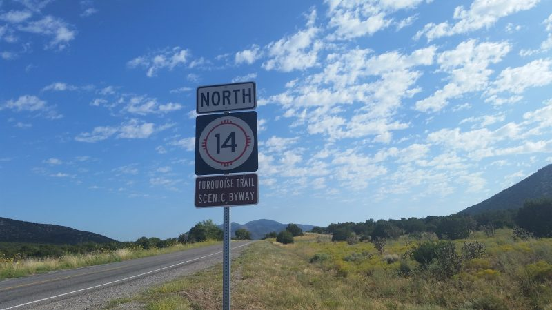A road sign indicating route 14 north on the Turquoise Trail in New Mexico.