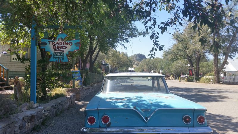 A turquoise-colored old car on the Turquoise Trail in New Mexico.