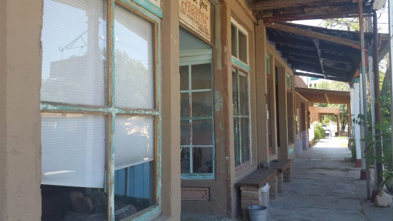 Old shopfronts with turquoise-colored window sills in the town of Los Cerrillos, New Mexico.