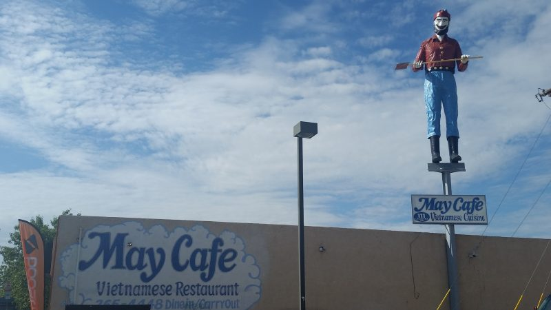A unique landmark in Albuquerque of a giant lumberjack on top of a Vietnamese restaurant.