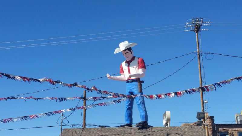 Fibreglass Muffler Man wearing a cowboy hat and gun holster in Gallup, New Mexico a.k.a as Dude Man.