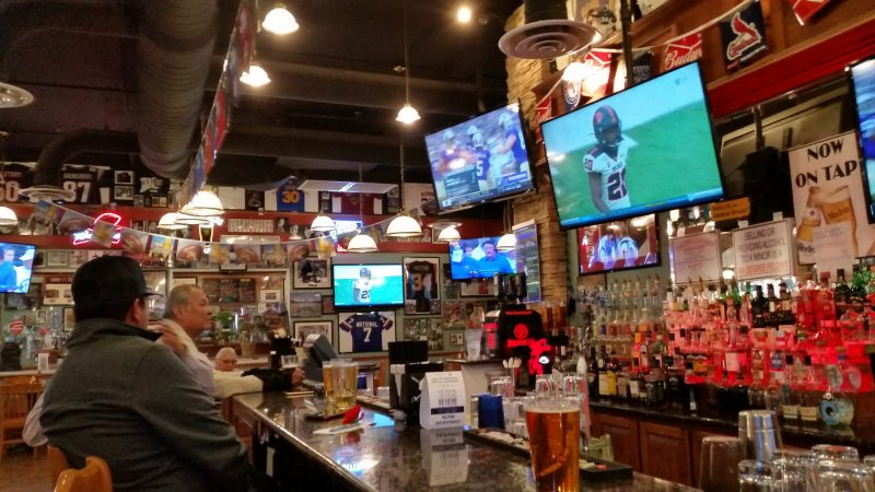 A sports bar and restaurant in Gallup, NM with televisions and memorabilia hanging from the walls.