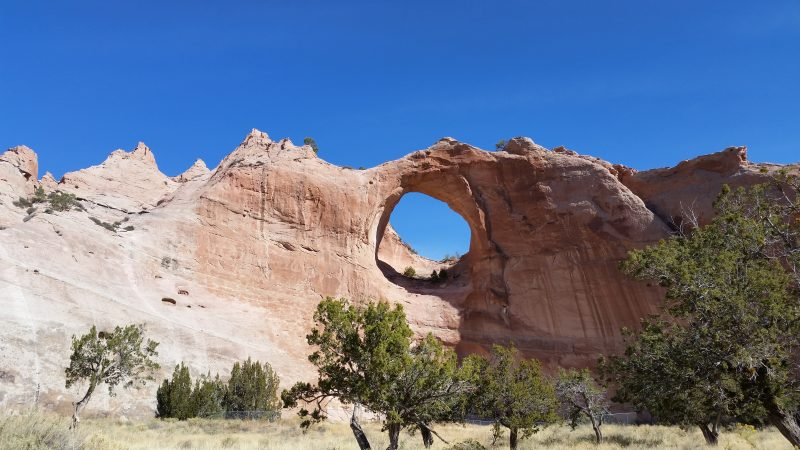 WindowRock Arizona. Tall sandstone cliff with large hole in it.