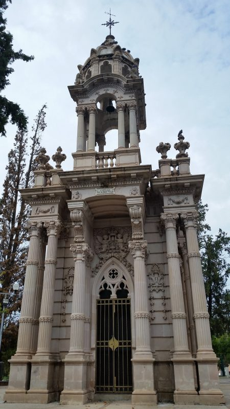 Ornate stone mausoleum of Pancho Villa with columns and a cupola.