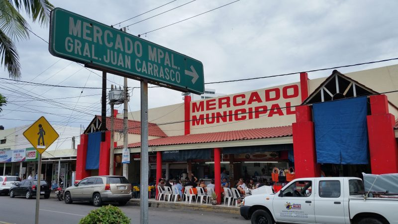 A municipal market in Mazatlan, Mexico featuring people eating at tables in the front.