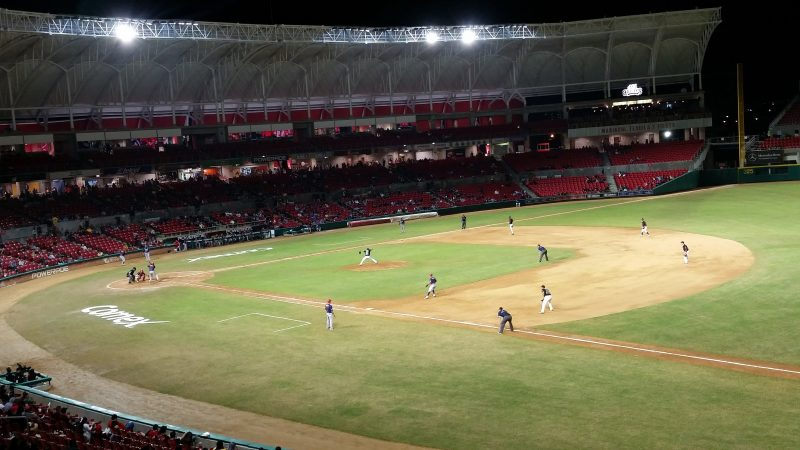 A view of the infield during a baseball game being played in a stadium at night under lights in Mazatlan, Mexico.