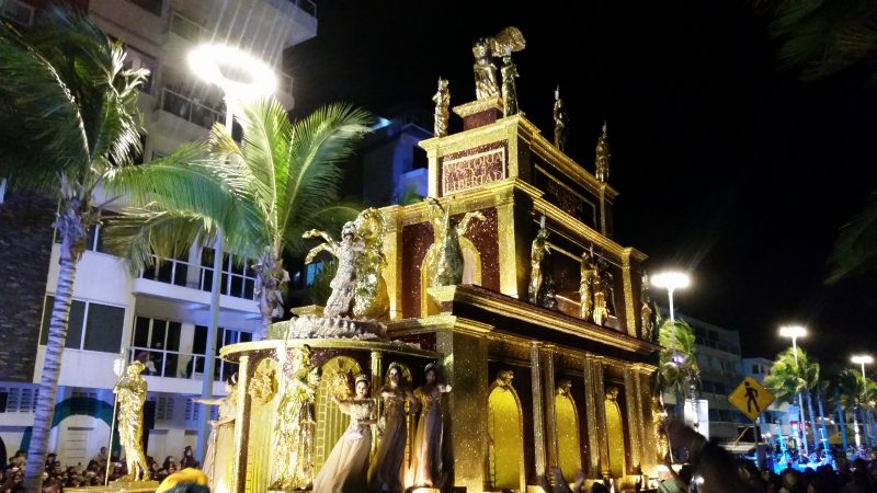 A giant gold parade float presided over by queen of the Mazatlan Carnaval.