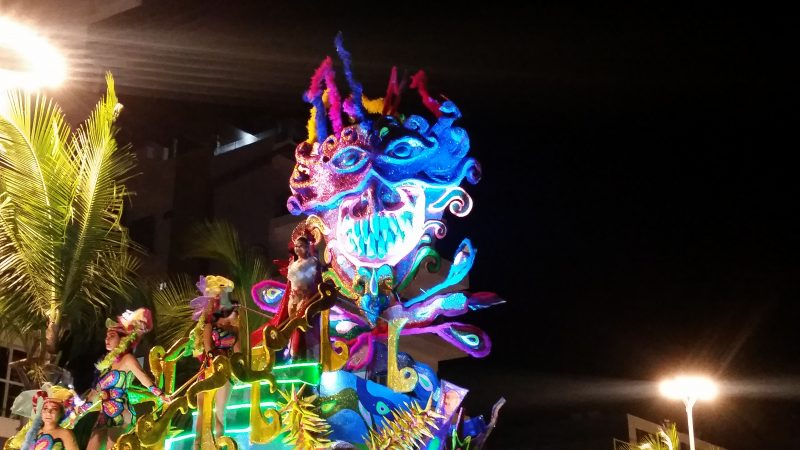 A very colorful parade float from Mazatlan's Carnaval depicting a demonic face.