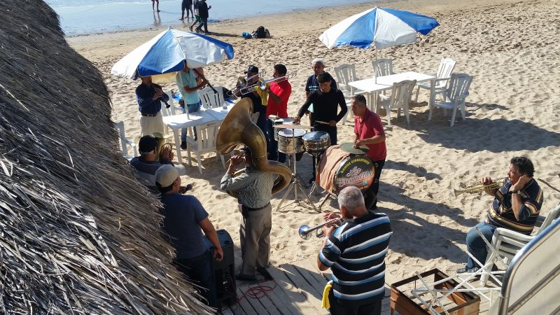 A Sinaloense band practicing on a beach in Mexico.