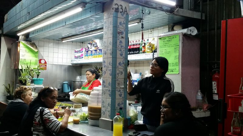 a group of women at an all-night taco stand in Mazatlan.