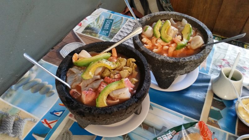 "Two volcanic stone ""molcajete"" bowls filled with shellfish and avocados at one of the many Mazatlan restaurants in Mexico serving seafood."