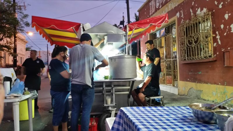 Patrons and workers surrounding a popular late night taqueria in Mazatlan, Mexico.