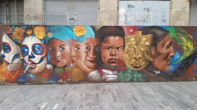 An example of colorful urban artwork of faces on the streets of Mexico City.