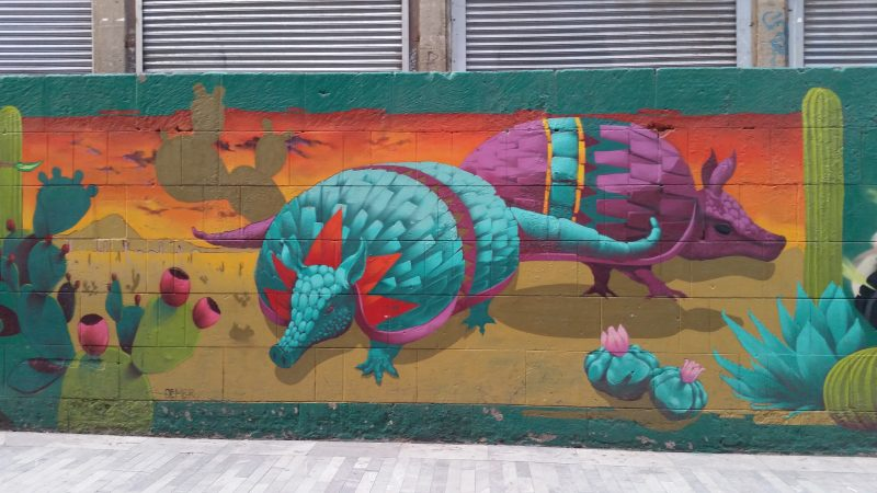 An example of colorful urban artwork of colorful armadillos on the streets of Mexico City.