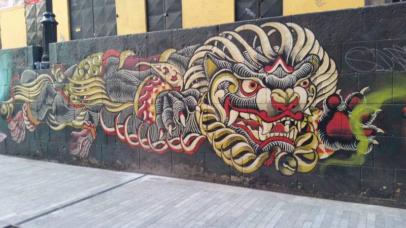 An example of colorful urban artwork of a Chinese dragon on the streets of Mexico City.