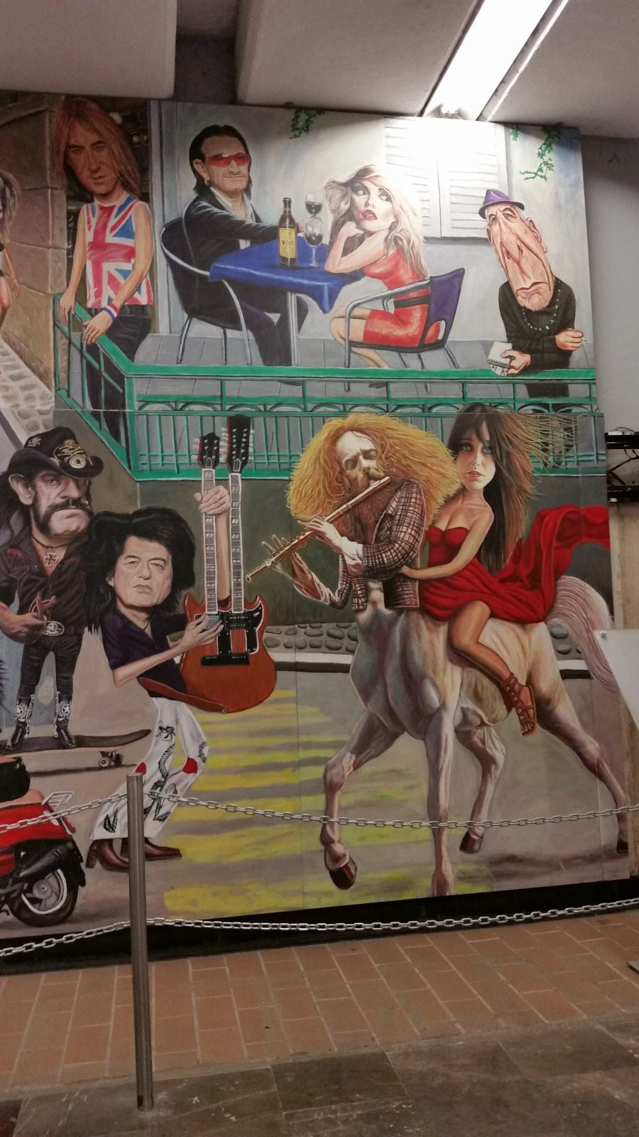 A view of the famous rock 'n roll murals in Auditorio Metro Station in Mexico City painted by artist Jorge Manjarrez showing Jimmy Page.