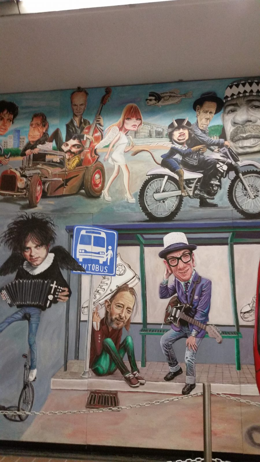 A view of the famous rock 'n roll murals in Auditorio Metro Station in Mexico City painted by artist Jorge Manjarrez showing Robert Smith from The Cure and Elvis Costello.