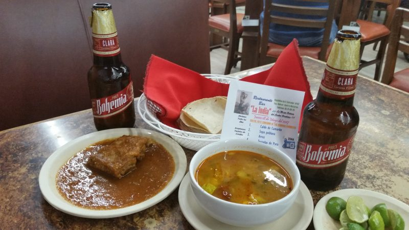 A plate of ribs and a soup, served as botanas in a cantina in Mexico City.