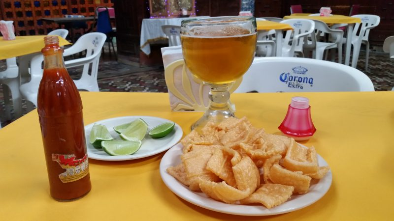 A plate of the botanas known as duras and a mug of beer in a cantina in Mexico City.