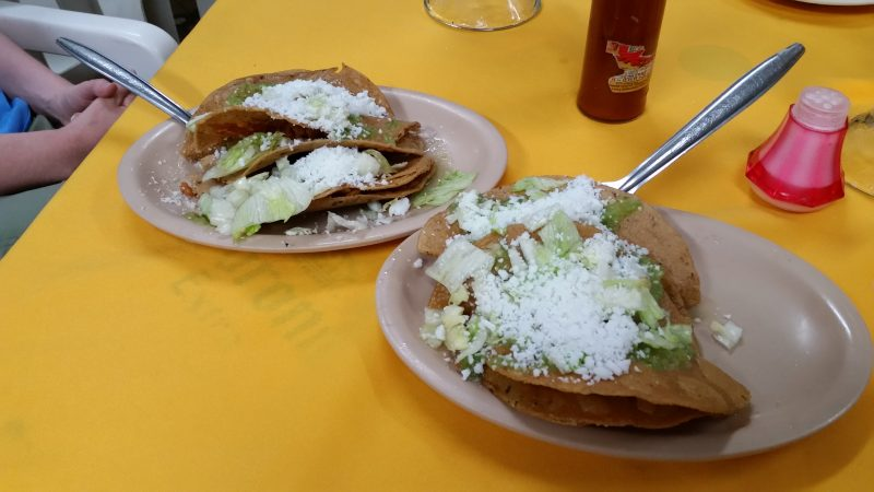 Two plates of tacos doradas served as botanas in a cantina in Mexico City.