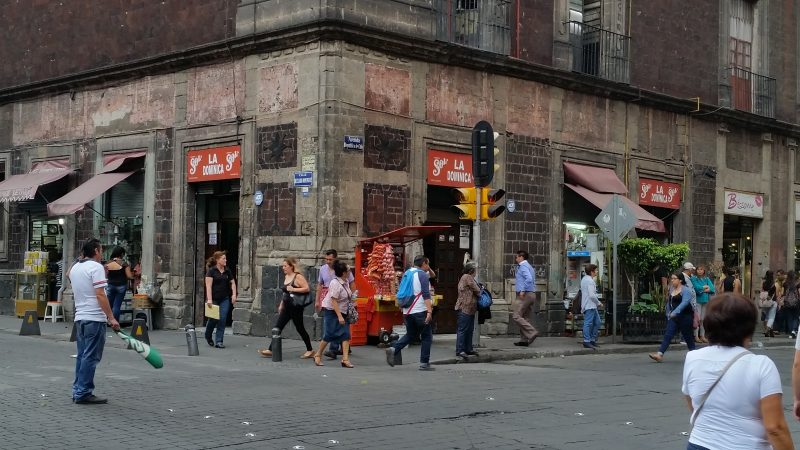 People walking in front of the La Dominica cantina in Mexico City.