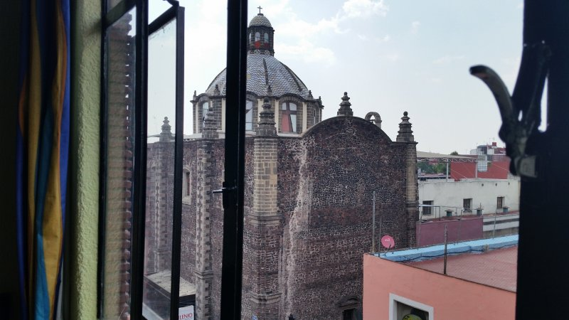 view of old church from hotel window, mexico city.