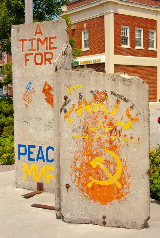 Two sections of the Berlin wall with old graffiti on display outside in Portland, Maine.