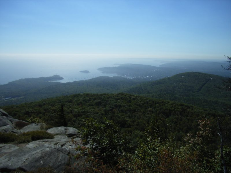 Looking out toward Camden Harbor from Camden Hills State Park, one of the most popular day trips from Portland, Maine.
