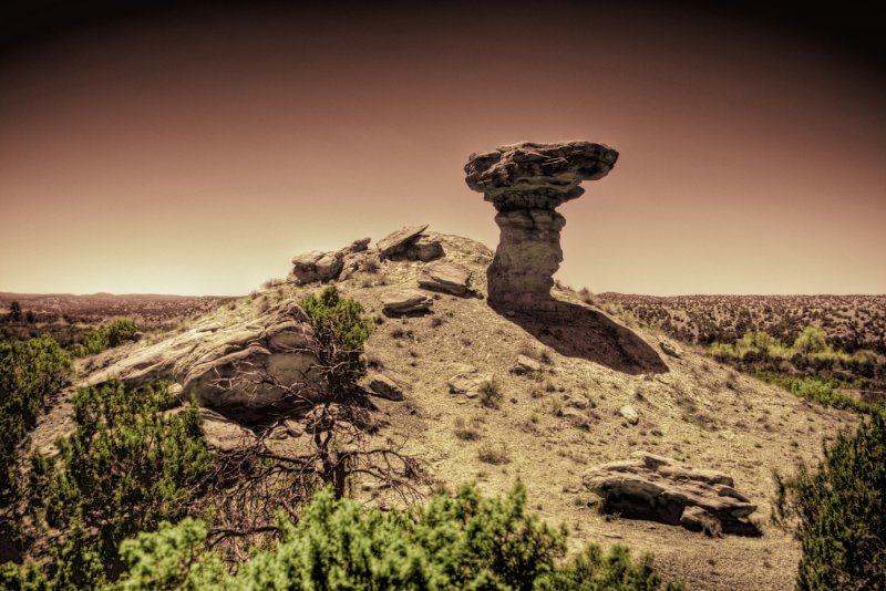 A sepia photo of a rock formation resembling a camel near Santa Fe.
