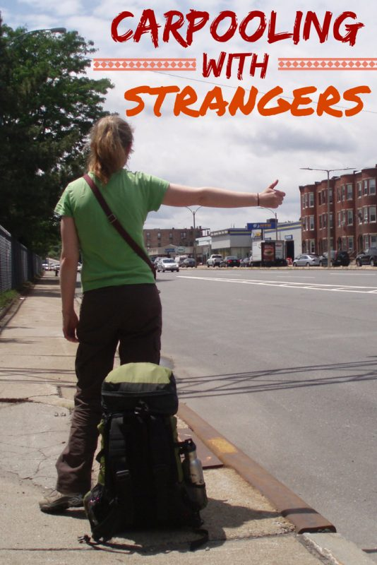 woman with backpack hitchhiking on the side of the road.