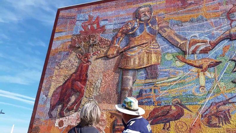 A woman being shown around on a city tour of Mazatlan.