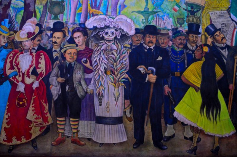 A colorful Diego Rivera Mural in Mexico City featuring assorted people.