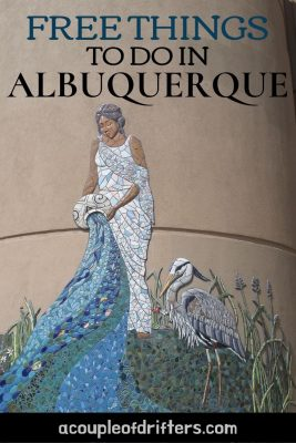 A painting on the side of a building in Albuquerque depicting a woman in a white dress poring water from a white jug.
