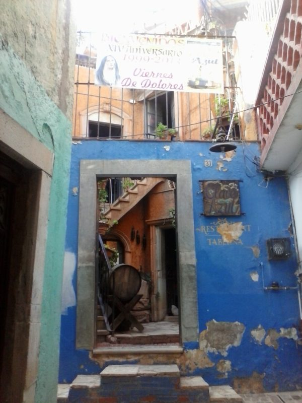 A weathered blue building of the bar Clave Azul in Guanajuato, Mexico.
