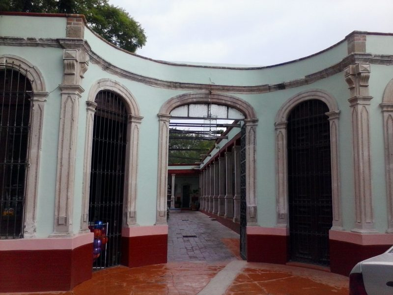 A green, arched colonial bath house building in Aguascalientes, a city in Mexico off the beaten path of many tourists.