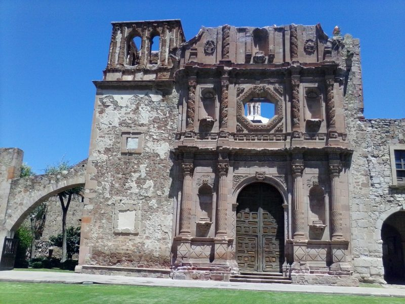 A ruined Jesuit Convent in Zacatecas, Mexico with a blue, cloudless sky in the background.