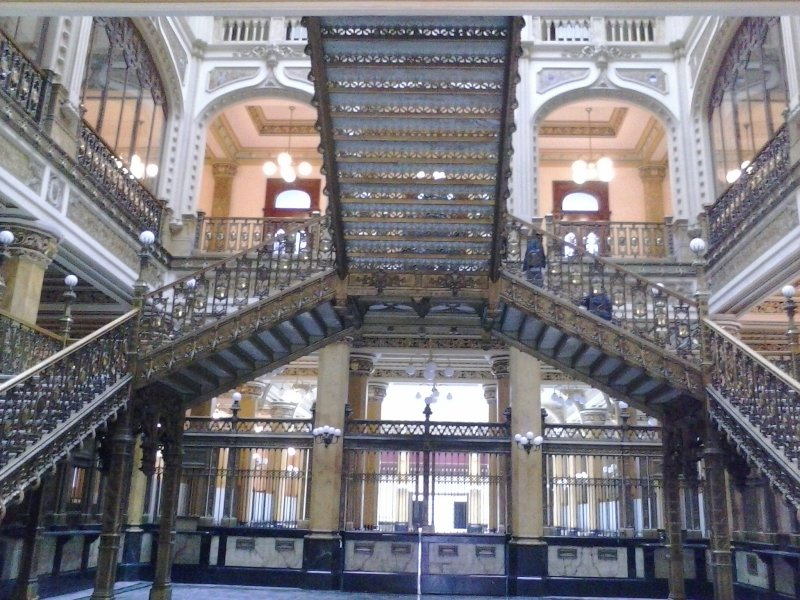 very ornate ironwork from the lobby of an old building.