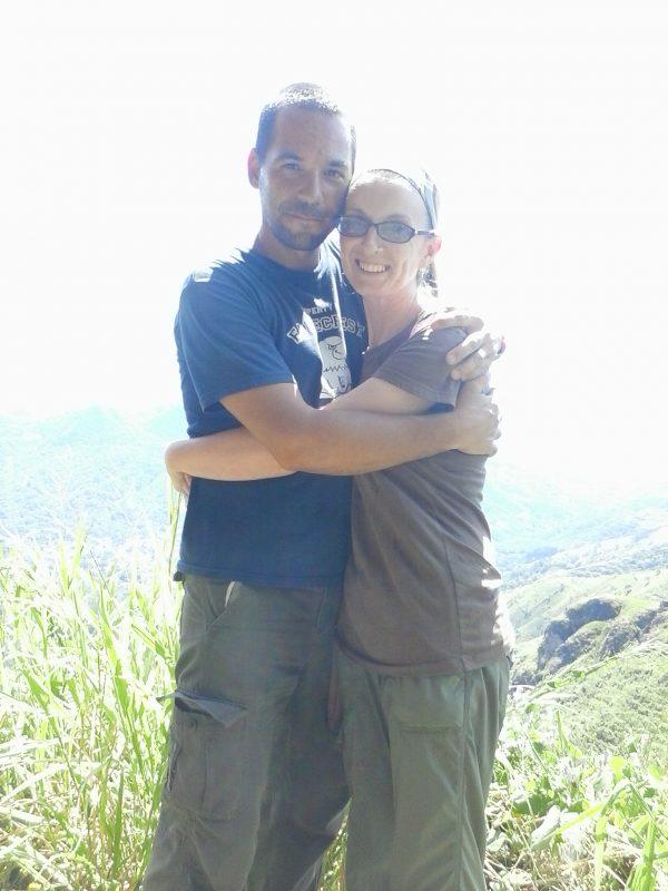 A man and a woman embracing at an overlook in San Salvador, El Salvador.