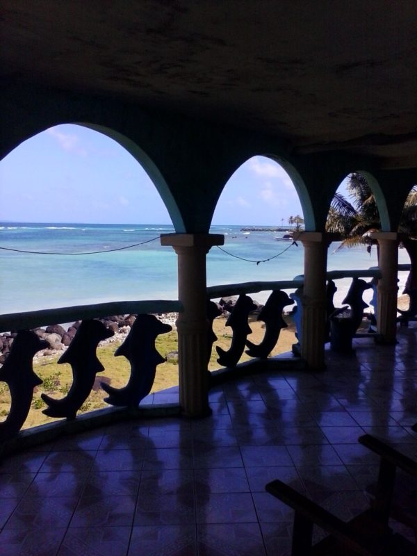 Exterior of the turquoise-colored Beach View Hotel on Big Corn Island off the coast of Nicaragua.