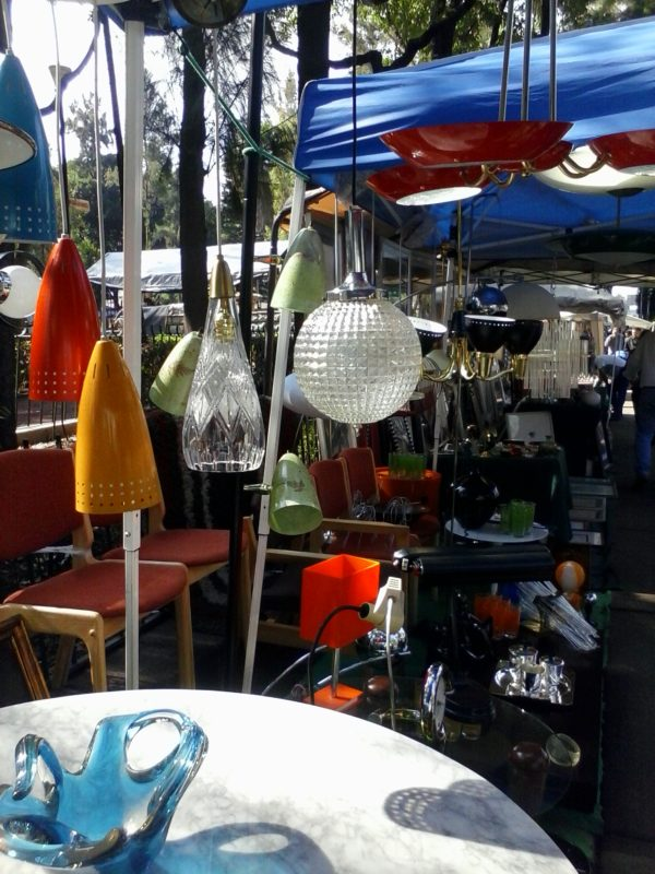 Vintage, multi coloured light shades and fixtures at a flea market in Mexico City.