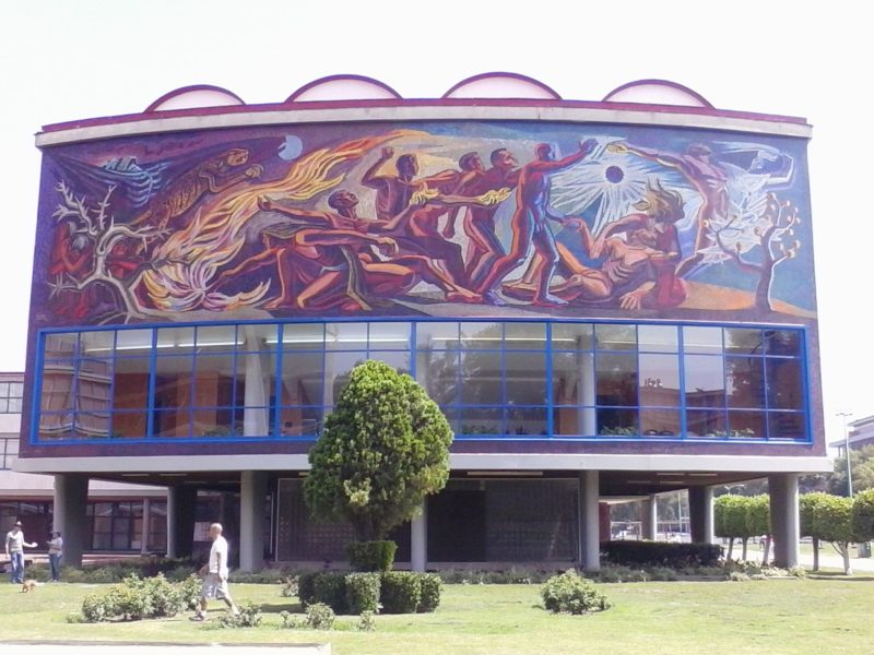Mural of naked men and a tiger leaping over flames, UNAM, Mexico City.
