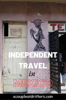 A photo of an old white door and a pink building advertising independent travel in Mexico.