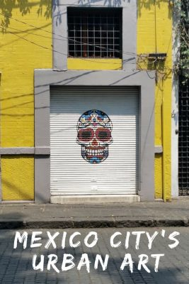 An example of colorful urban artwork of a skull on the streets of Mexico City.