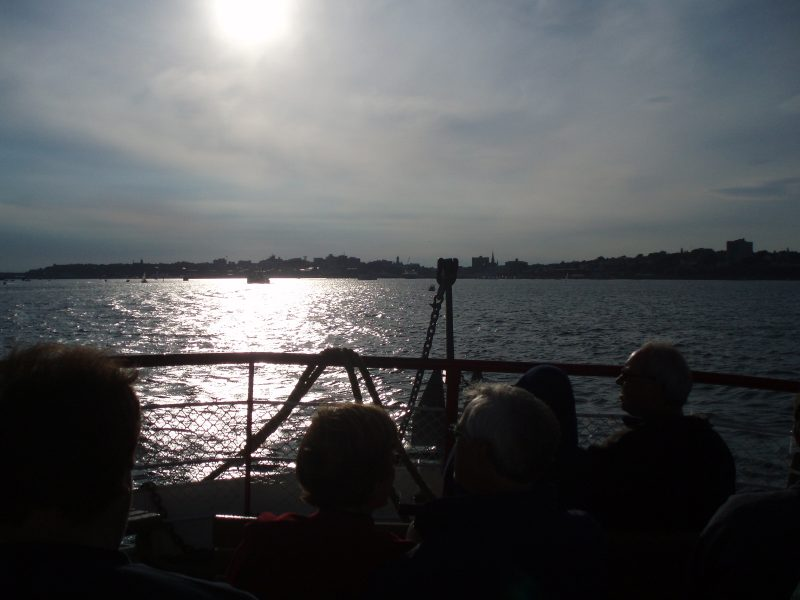 Passengers on a Casco Bay Lines ferry enjoying one of the most easily accessible day trips from Portland, Maine.