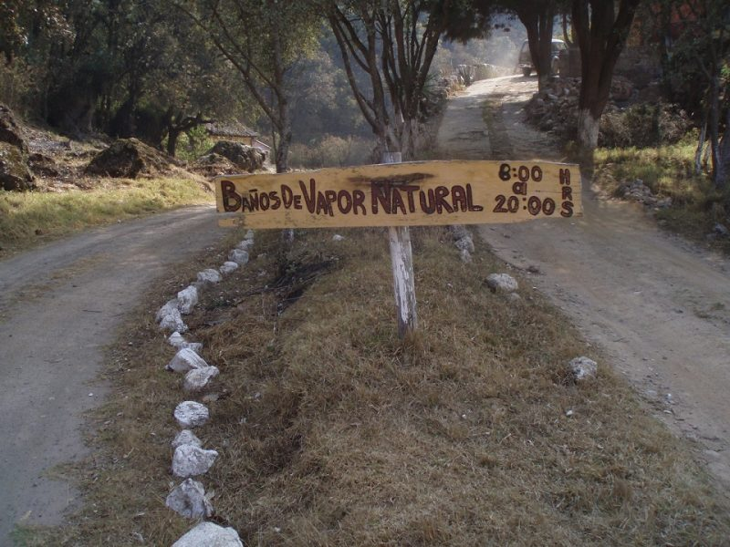 wooden sign advertising a steam sauna in the mountains of Guatemala.