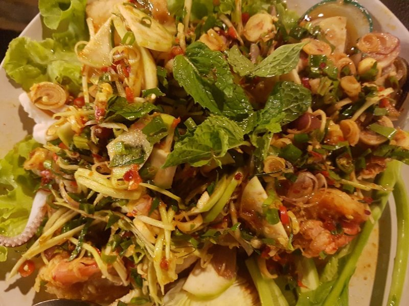 A plate of Yum Nua salad, a popular Thai food dish.